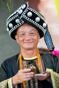 A tea server is seen in traditional costume at the Yunnan pavilion at the fair