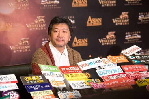 Japanese film director HIROKAZU KORE-EDA speaks to the gathered press at the10th Asian Film awards press conference. He is nominated for best director with his film Our Little Sister.