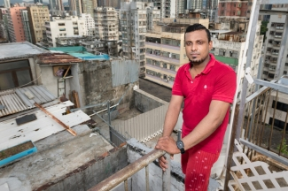 Refugee Supun Thilina Kellapatha.This is the roof of their building showing the illegal structures in this poor area of the city.Edward Snowden in hiding in Hong Kong.