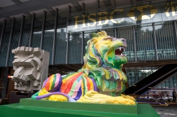 Rainbow pride lions are displayed in support of LGBTI people at the HSBC Headquarters in Central Hong Kong. Their display has caused controversy and prompted a petition for their removal as well as threats by customers to close their accounts. The lions are replicas in rainbow colours of Stephen and Stitt, the bankÕs iconic lions, in front of its main building. The statues, designed by local LGBT artist Michael Lam,represent pride and unity in diversity, with Stephen painted in stripes (pictured) and Stitt in circles. Throughout the bankÕs history, the lions have stood for courage and prosperity.#HSBCPride . © Jayne Russell 6th December 2016